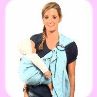 Llevar a tu bebé con una bandolera. Portabebés