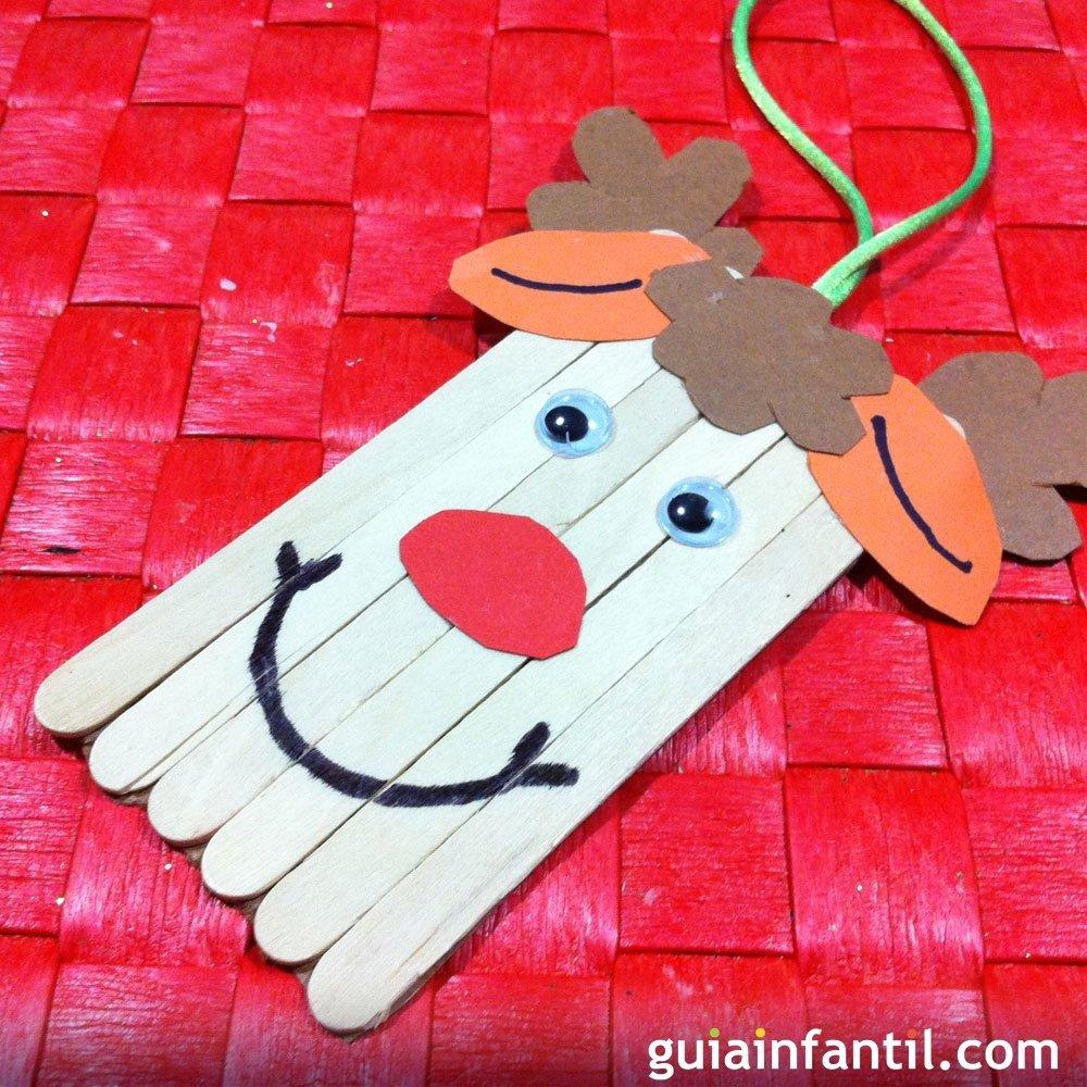 Un reno de papa no l con palos de madera manualidad navide a - Adornos navidenos ninos ...