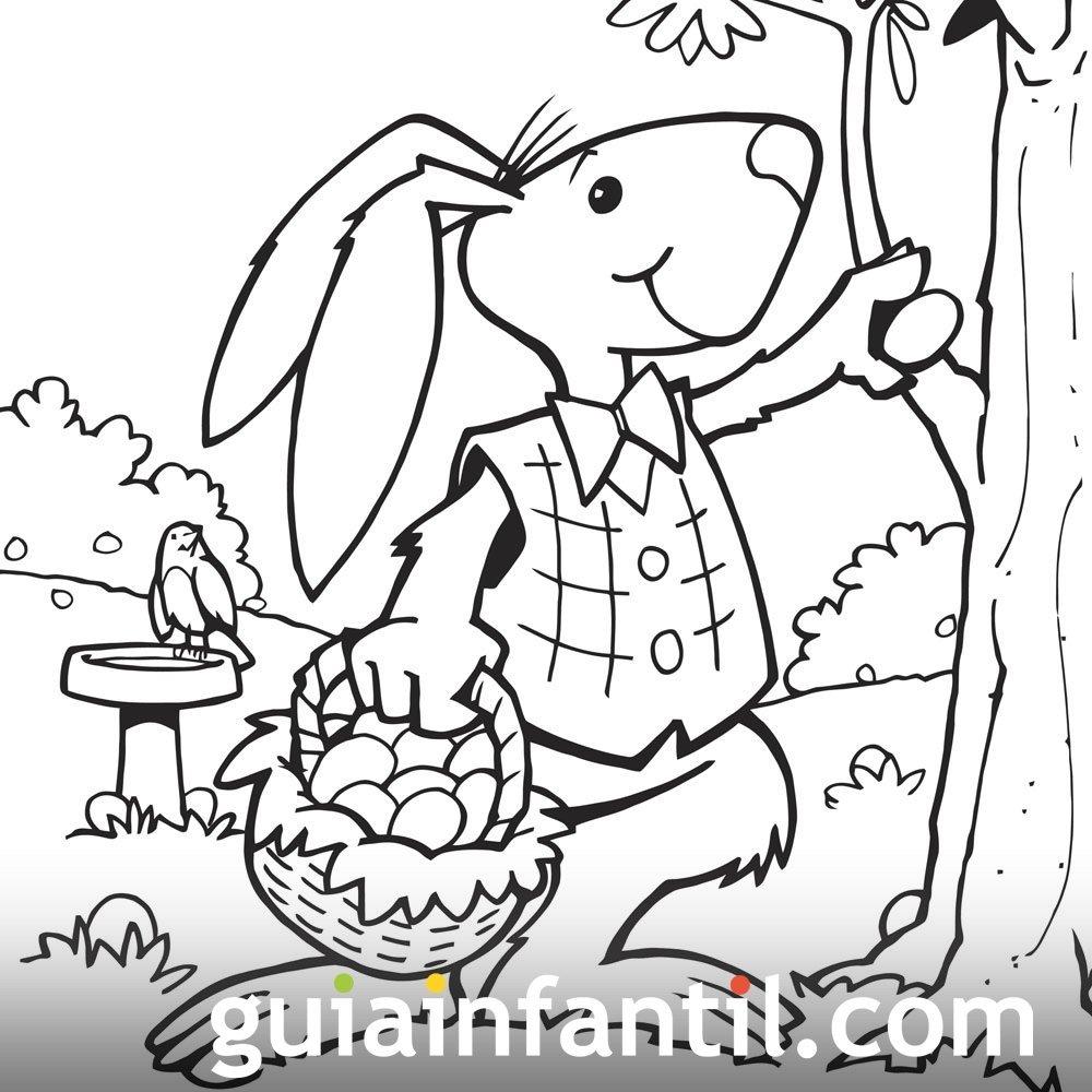Dibujo para colorear de un conejo de Pascua con su cesta de huevos
