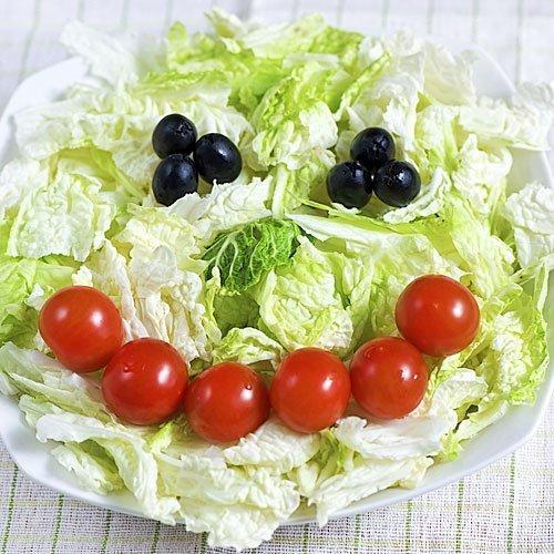 Ensalada con sonrisa de tomatitos para niños