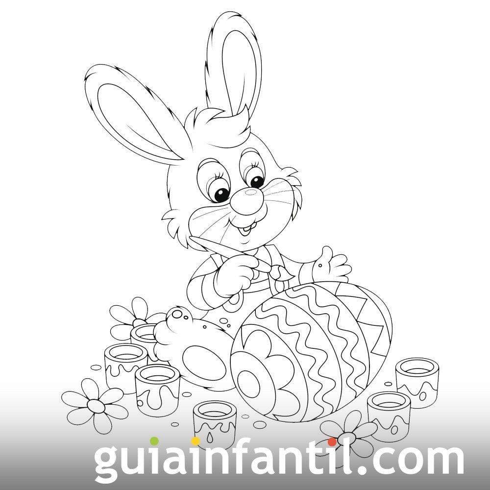 Conejo pintando huevo de Pascua