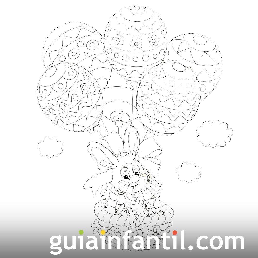 Conejo con un paracaídas de huevos de Pascua