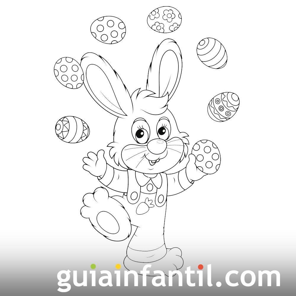 Conejo haciendo malabarismo con huevos de Pascua