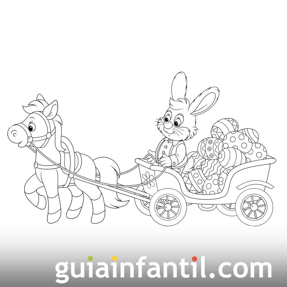 Conejo llevando huevos de Pascua en un carruaje