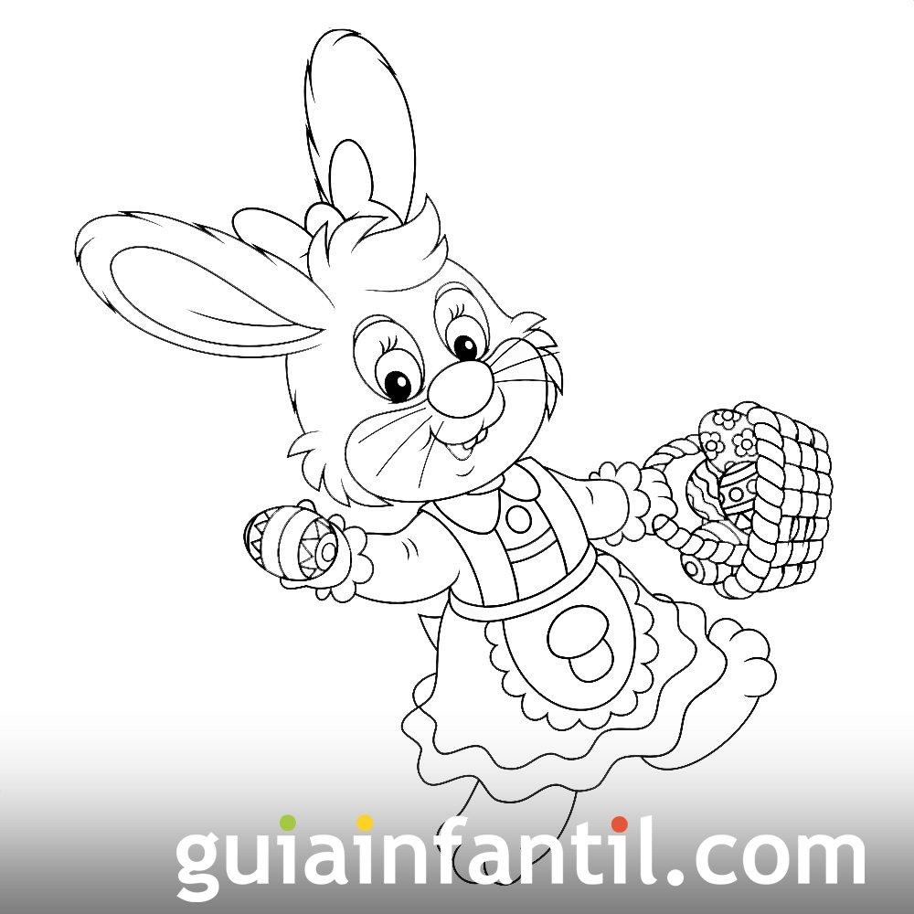 Coneja de paseo con una cesta de huevos de Pascua