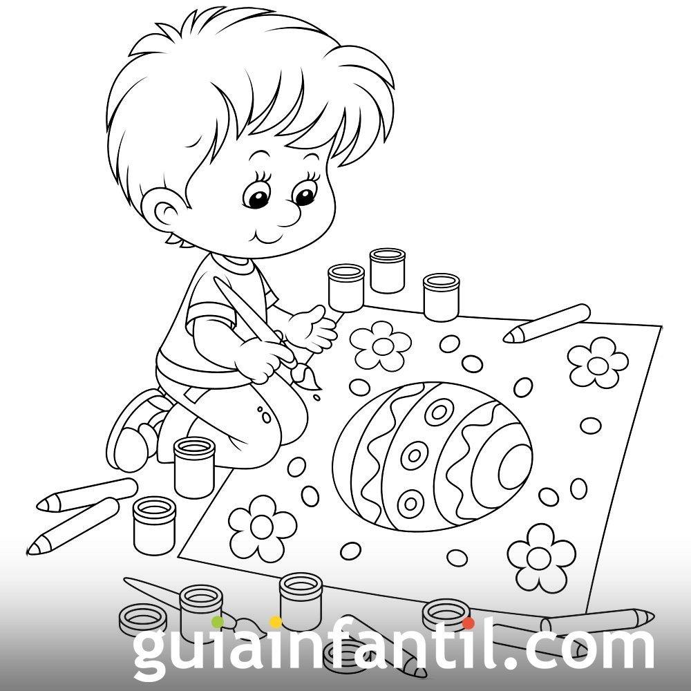 Niño pintando un gigante huevo de Pascua