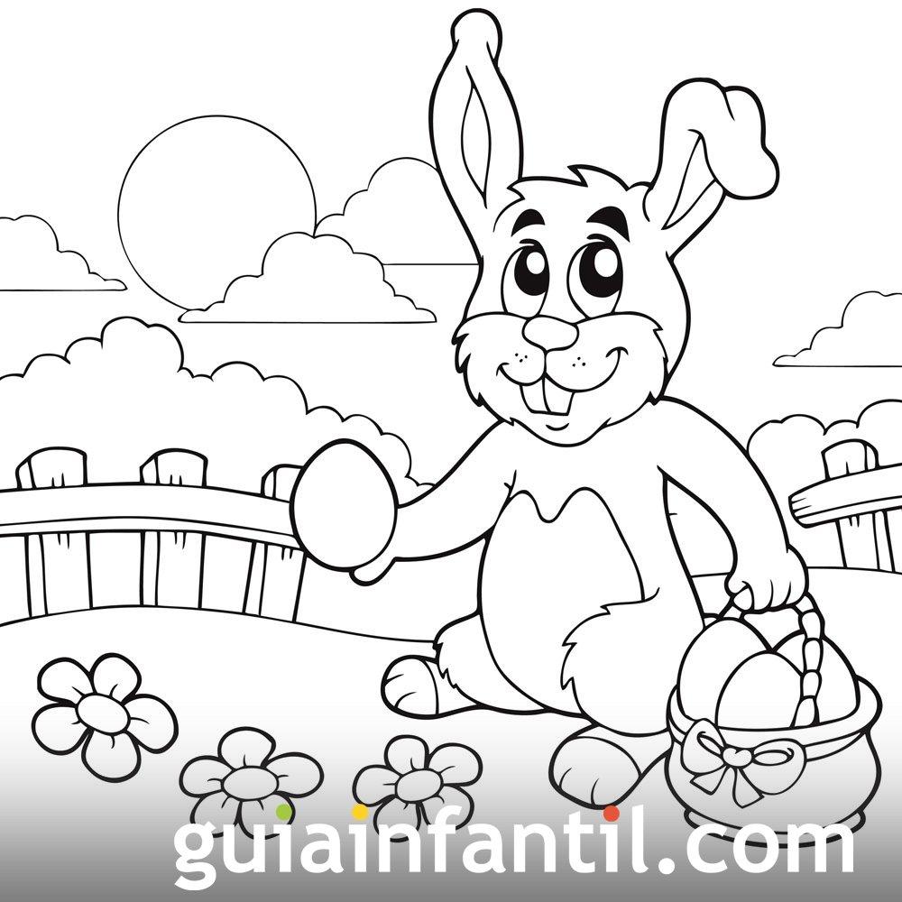Conejo alegre llevando una cesta de Pascua