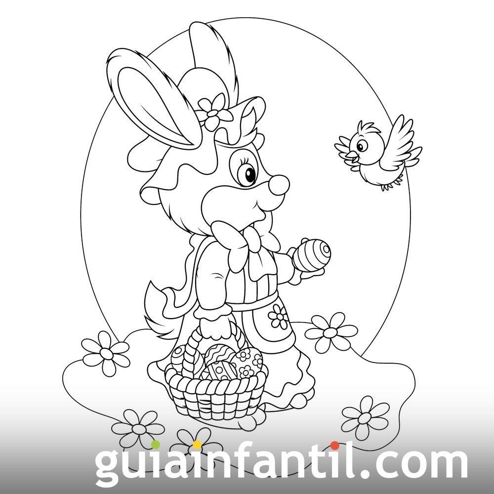 Coneja lleva cesta de huevos de Pascua