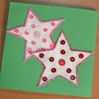 postal de navidad con estrellas con fieltro