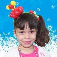 Diadema adornada con una flor de Navidad de globos para niñas