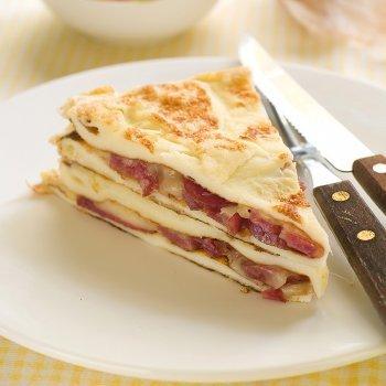 Lasaña de tortilla con jamón y queso