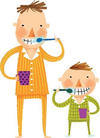 Padre con hijo se lavan dientes