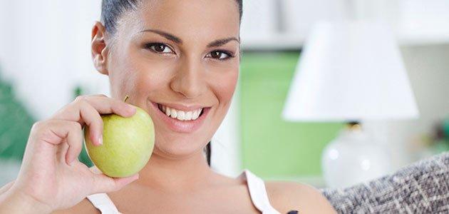 Embarazada con manzana