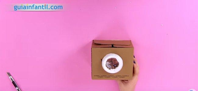 Caja marco con forma de cámara de fotos. Paso 3
