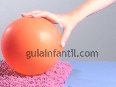 Rodar una lata con un globo. Paso 2.