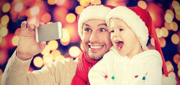 Padre con niño Navidad movil