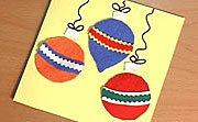 Tarjeta con bolas navideñas